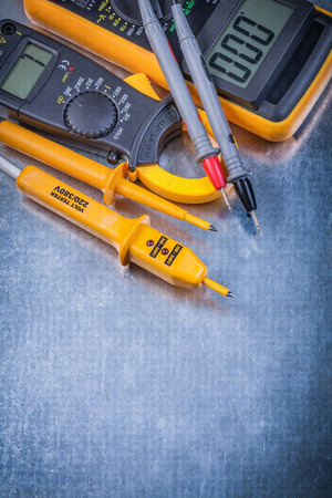 ammeter: Digital ammeter electrical tester multimeter on metallic background electricity concept. Stock Photo