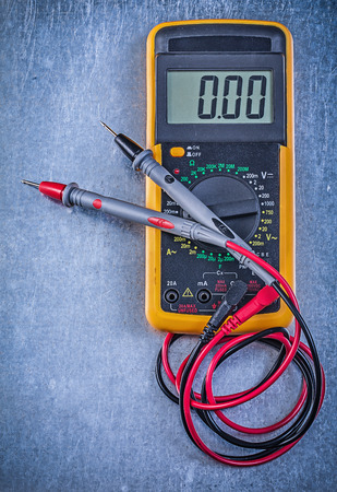 current: Digital electrical tester current probe on metallic background.