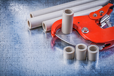 coupling: Set of pipe coupling tools on metallic background construction concept. Stock Photo