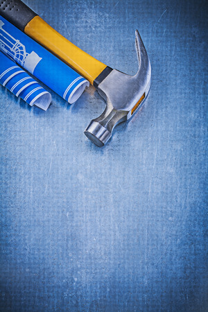claw hammer: Blue engineering drawings claw hammer on metallic background construction concept.
