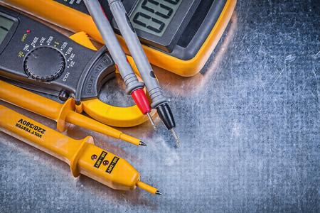 the tester: Digital amperemeter electrical tester multimeter on metallic background.