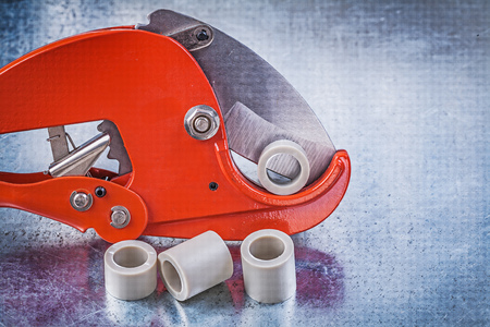 waterpipe: Pipe cutter water tube on metallic background construction concept.