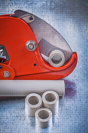 waterpipe: Sharp pipe cutter water tubes on scratched metallic background construction concept.