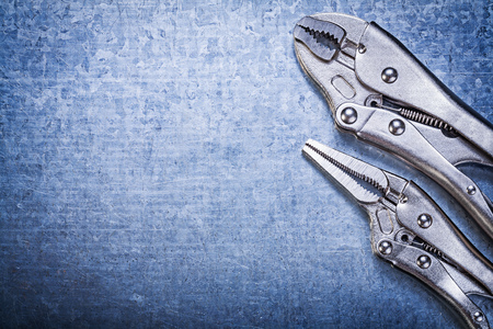 fix jaw: Stainless lock jaw pliers on metallic background construction concept.