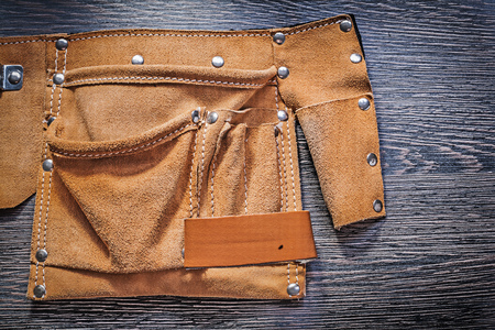 tool belt: Leather tool belt on wooden board construction concept. Stock Photo