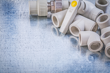 waterpipe: Water valve threaded pipe connectors on metallic background construction concept. Stock Photo