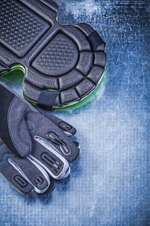 protectors: Set of gardening safety gloves knee protectors on metallic background agriculture concept.