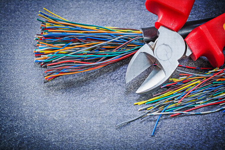 wire cutter: Electrical cables sharp wire cutter on black background electricity concept. Stock Photo