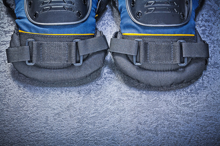protectors: Pair of knee protectors on black background construction concept. Stock Photo