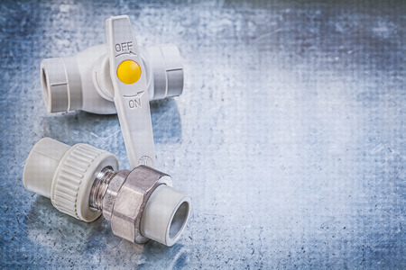 waterpipe: Water valve threaded pipe fitting on metallic background copy space construction concept.