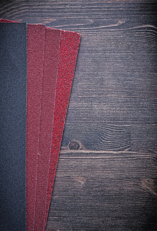 emery paper: Polishing sheets of paper on vintage wooden board abrasive materials.