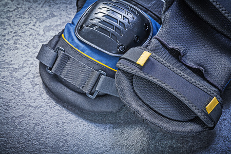 knee pads: Knee pads on black background directly above construction concept.