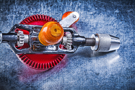 hand drill: Vintage hand drill on metallic background directly above. Stock Photo