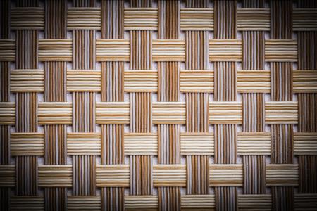 beach mat: old dusted wicker mat texture close up.