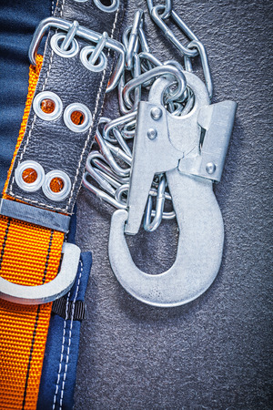 safety harness: Safety harness with metal chain on black background maintenance concept.