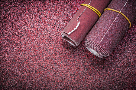emery paper: Rolled glass-paper on abrasive sheet.