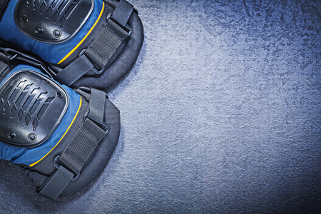 knee pads: Protective knee pads on black background construction concept.