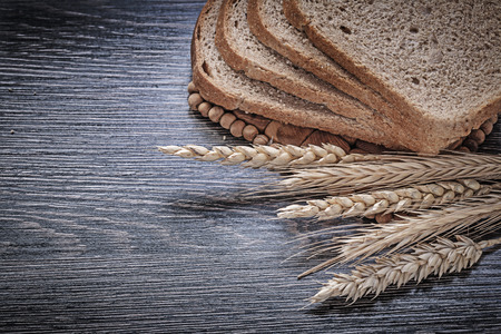 sliced bread: Rye wheat ears sliced bread food and drink concept. Stock Photo