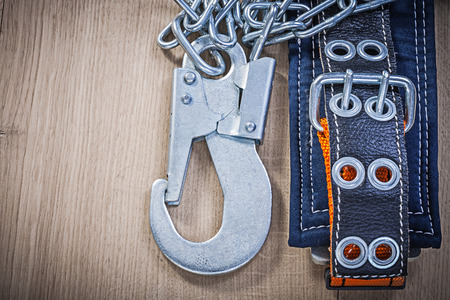 safety harness: Safety harness on wooden board construction concept. Stock Photo