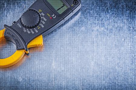 dielectric: Digital amperemeter on metallic background.