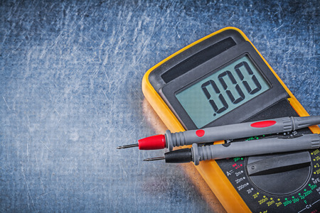test probe: Digital electric tester wires current probe on scratched metallic background. Stock Photo