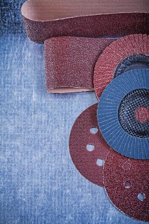 flap: Sandpaper abrasive discs flap grinding wheels on metallic background. Stock Photo