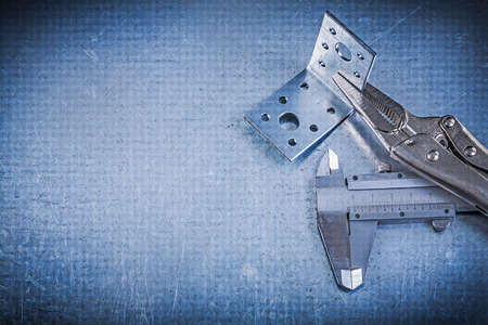 fix jaw: Lock jaw pliers vernier caliper angle bracket on metallic background.