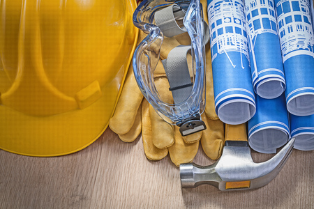 protective spectacles: Composition of construction tools on wood board horizontal version.