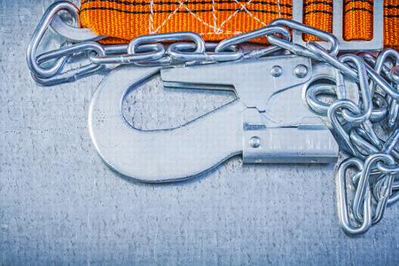 safety belt: Safety belt metal chain carabiner on scratched metallic background directly above.