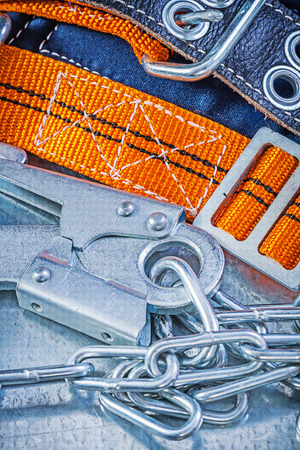 metal chain: Construction harness metal chain carabiner on metallic background.