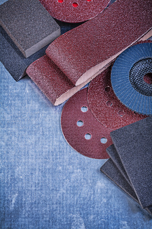 emery paper: Set of abrasive materials on metallic background vertical view. Stock Photo