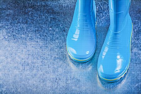 gum boots: Waterproof gum boots on metallic background.