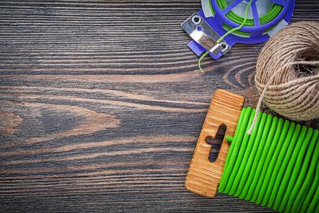 hank: Garden tie wire hank of string on wooden board gardening concept.