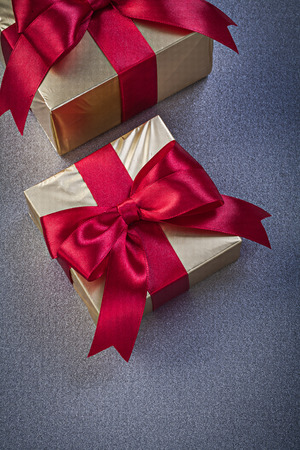 packed: Packed giftboxes on grey background holidays concept. Stock Photo