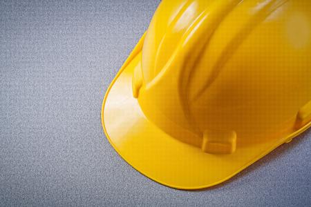 hard hat: Hard hat on grey background construction concept.