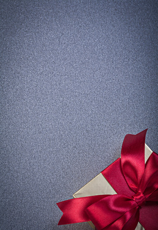 giftbox: Giftbox wrapped in glittery paper on grey background copy space holidays concept.