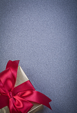glittery: Gift box wrapped in glittery paper on grey background