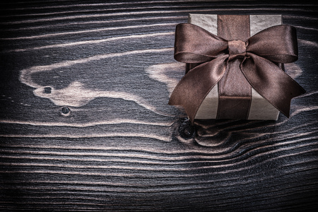 packed: Packed present box on wooden board