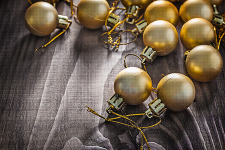 knack: golden christmas balls on wooden board.