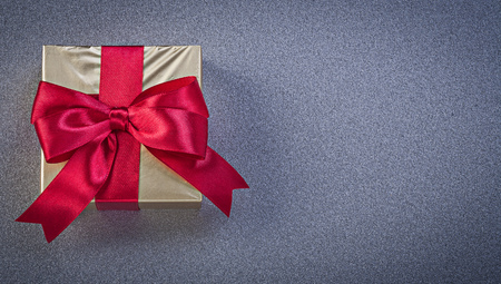 glittery: Present box wrapped in glittery paper on grey background
