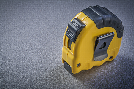 manual measuring instrument: Measuring tape on grey background Stock Photo