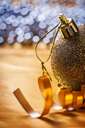 knack: golden christmas bauble close up. Stock Photo
