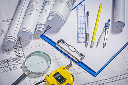 architect tools: architect tools; blueprints, clipboard, magnifier and ruler.