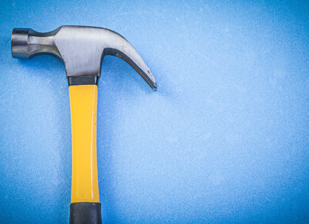 claw hammer: Claw hammer on blue background Stock Photo