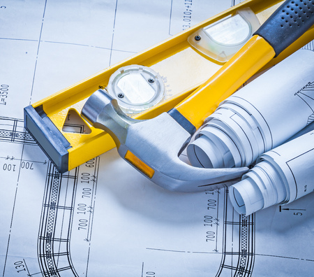 claw hammer: Construction level, claw hammer and rolls of blueprints