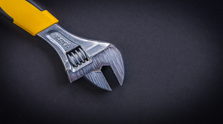 close up  wrench: adjustable wrench with yellow handle. Stock Photo
