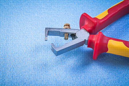 strippers: Insulation strippers on blue background