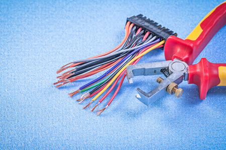 electric wires: Insulation strippers and electric wires on blue background Stock Photo