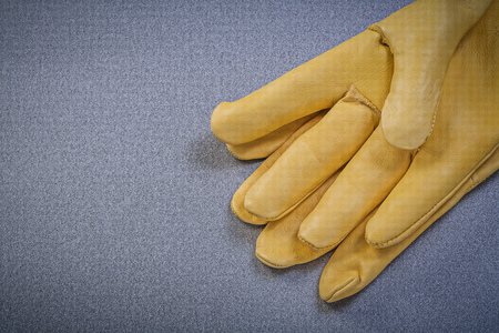 protective gloves: Yellow protective gloves on grey background Stock Photo