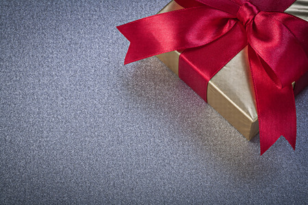 packed: Packed present box on grey background Stock Photo